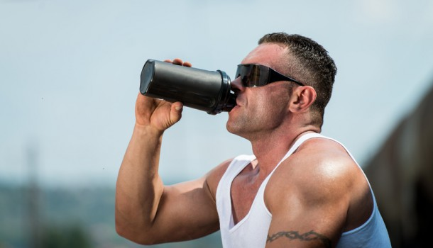 Bodybuilder Resting And Drinking Protein Shake